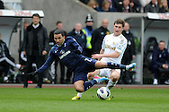 Tottenham's Aaron Lennon is tackled by Swansea's Ben Davies. Barclays Premier League, Swansea city v Tottenham Hotspur at the Liberty Stadium in Swansea, South Wales on Saturday 30th March 2013. pic by Andrew Orchard, Andrew Orchard sports photography,