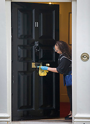 © Licensed to London News Pictures. 15/03/2016. London, UK. The door to Number 11 Downing Street is cleaned the day before Chancellor of the Exchequer George Osborne presents his budget to Parliament. Photo credit: Peter Macdiarmid/LNP