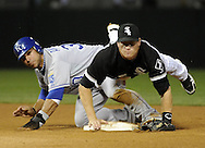 CHICAGO - JULY 09:  Gordon Beckham #15 of the Chicago White Sox gets the force out at second base as Mike Aviles #30 of the Kansas City Royals breaks up the play on July 9, 2010 at U.S. Cellular Field in Chicago, Illinois.  The White Sox defeated the Royals 8-2. (Photo by Ron Vesely)