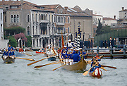 Traditional boating festival and carnival along canal in Venice, Italy