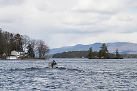 Alan Volk heads out around Lockes Island from the Glendale town docks on his way to Mark Island Thursday afternoon.  (Karen Bobotas/for the Laconia Daily Sun)