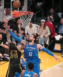 February 8, 2018 - Los Angeles, California, U.S - Brandon Ingram #14 of the Los Angeles Lakers goes for a layup as Steven Adams #12 of the Oklahoma Thunder tries to stop him during their NBA game on Thursday February 8, 2018 at the Staples Center in Los Angeles, California. Lakers vs. Thunder. (Credit Image: © Prensa Internacional via ZUMA Wire)