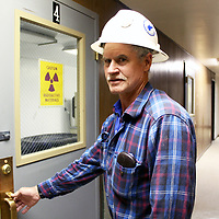 Bruce Norquist, facility manager, will step into shoes vacated by Mount Taylor Mine Manager Joe Lister later this year. Norquist prepares to enter a newly revamped room at the mine that has been set aside for contractors to test soil samples.