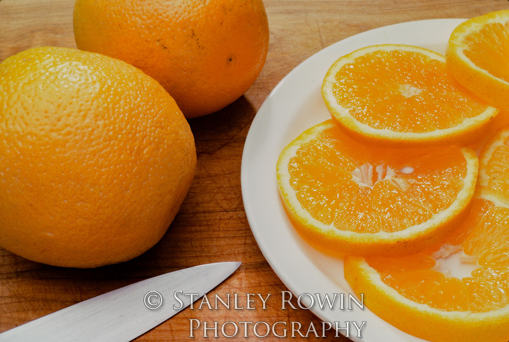 Sectioned and sliced naval oranges