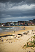 Few walkers on Nigrán beach in spring, Galicia, Spain Ⓒ Davis Ulands | davisulands.com