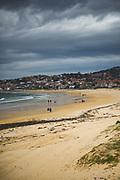 Few walkers on Nigrán beach in spring, Galicia, Spain Ⓒ Davis Ulands   davisulands.com