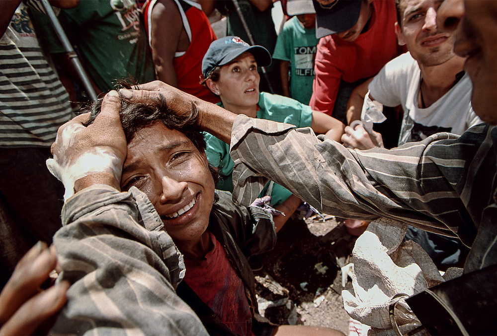 An American medical team treats a woman's self-inflicted laceration at La Church, a massive garbage dump outside Managua, Nicaragua. The woman was advised to return to a makeshift clinic, but instead disappeared into the fields of waste.