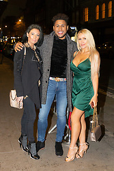 Former Playboy model Hayley Bray, right, poses for a picture with friends whilst out and about In London as she arrives at Studio 61 Cocktail Bar at Sway in Holborn. LONDON, December 28 2018.