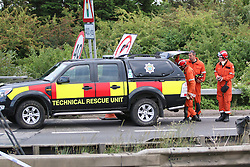 © Licensed to London News Pictures. 22/08/2015. Shoreham, UK.  Emergency services at the scene where a fighter jet crashed in to cars on the A27 road in front of thousands of spectators at the Shoreham Airshow in West Sussex. Today August 22th 2015. Photo credit : Hugo Michiels/LNP