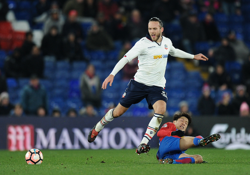 Bolton Wanderers' Tom Thorpe holds off the challenge from Crystal Palace's Lee Chung-Yong<br /> <br /> Photographer Ashley Western/CameraSport<br /> <br /> Emirates FA Cup Third Round Replay - Crystal Palace v Bolton Wanderers - Tuesday 17th January 2017 - Selhurst Park - London<br />  <br /> World Copyright © 2017 CameraSport. All rights reserved. 43 Linden Ave. Countesthorpe. Leicester. England. LE8 5PG - Tel: +44 (0) 116 277 4147 - admin@camerasport.com - www.camerasport.com