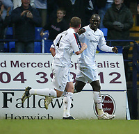 Photo: Aidan Ellis.<br /> Bolton Wanderers v Arsenal. The Barclays Premiership.<br /> 03/12/2005.<br /> Bolton's Abdoulaye Faye celebrates scoring the first goal with Kevin Nolan