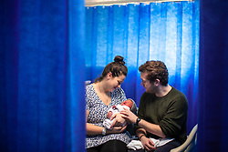 © Licensed to London News Pictures . 25/02/2021. Bolton , UK . New patents JOANNA LOMAX (27) and ANTHONY COOKE (32) with their one-day-old son PATRICK . A look at maternity wards at the Royal Bolton Hospital during Coronavirus restrictions . Photo credit : Joel Goodman/LNP
