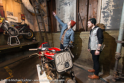 Checking out the displays on Friday night at the One Show motorcycle show in Portland, OR. February 12, 2016. ©2016 Michael Lichter