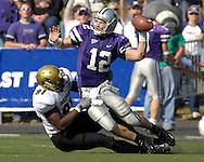 Colorado defensive end Maurice Lucas (91) pulls down Kansas State quarterback Allan Evridge (12) as he tries to get rid of the ball in the second quarter at KSU Stadium in Manhattan, Kansas, October 22, 2005.  The Buffaloes beat K-State 23-20.