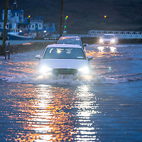 Cars drive through water in Kinsale at high tide as the Bandon river flooded parts of the town.<br /> Picture. John Allen