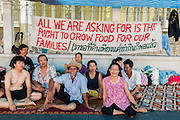 "11 MAY 2013 - BANGKOK, THAILAND:   Several hundred small scale family farmers camped out ""Government House"" (the office of the Prime Minister) in Bangkok to Thai Prime Minister Yingluck Shinawatra to deliver on her promises to improve the situation of family farmers. The People's Movement for a Just Society (P-move) is a network organization which aims strengthen the voices of different, but related causes working to bring justice for marginalized groups in Thailand, including land rights for small-scale farmers, citizenship for stateless persons, fair compensation for communities forced to relocate to accommodate large scale state projects, and housing solutions for urban slum dwellers, among others.   PHOTO BY JACK KURTZ"
