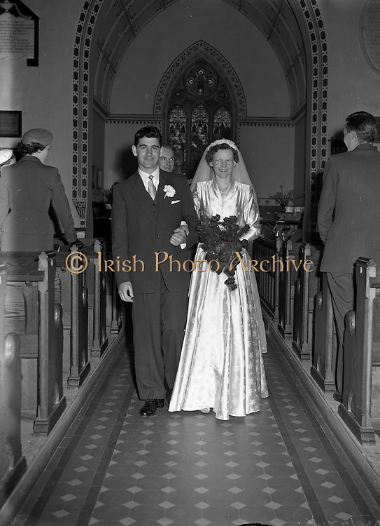 30/03/1957<br /> 03/30/1957<br /> 30 March 1957<br /> Wedding of Lee - Hill at Finglas Parish Church (Church of Ireland) and the Spa Hotel, Lucan, Dublin. Bride and groom coming down the aisle after the ceremony.