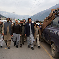 Imran Khan and Tehrik-e-insaaf party workers spend time with communities in the Balakot district affected by the October 2005 earthquake which killed over 70,000 people in Pakistan. Khan and his party Tehrik-e-insaaf have raised funds to provide relief to several communities affected by the earthquake.<br /> <br /> Cricketer Imran Khan made his Test debut against England in 1971. He became captain of the Pakistan team in 1982 and lead them to World Cup victory in 1992 after which he retired.<br /> <br /> Imran Khan established the Tehrik-e-insaaf (or Moverment for Justice) in 1996. Through Tehrik-e-insaaf, Khan has demanded that the Pakistan government make institutional reforms to address corruption and end the present dictatorship. Khan would like a more equitable distribution of resources in Pakistan, the granting key civil liberties and an increas in public service spending. He is particularly scathing of the relationship between President Musharraf and US President Bush.<br /> <br /> Imran Khan became a Member of the Pakistani Parliament for Mianwali, Panjab, in the October 2002 elections.<br /> <br /> Photo: Tom Pietrasik<br /> North West Frontier Province, Pakistan<br /> 29th January 2006