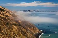 Steep and rugged hills and fog over the Sonoma coast; California