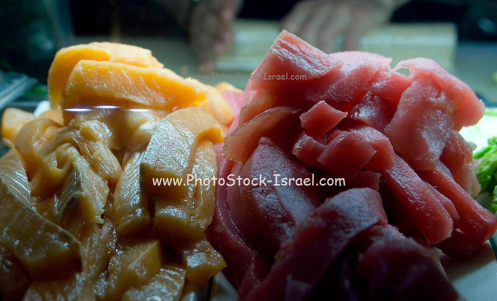 Fresh raw tuna and salmon cuttings ready for the preparation of sushi and sashimi