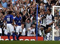 Photo: Chris Ratcliffe.<br />Tottenham Hotspur v Everton. The Barclays Premiership.<br />15/10/2005.<br />Mido And Jermaine Defoe celebrate Mido's opening goal as Simon Davies and Matteo Ferrari watch on