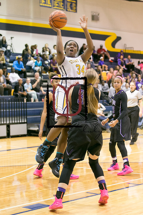 Stony Point's Soteria Banks attempts a shot over Cedar Ridge's Sydney Williams Friday at Stony Point.  The Tigers lost at home 75-37.  (LOURDES M SHOAF for Round Rock Leader.)
