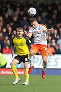 Luton Town forward James Collins heads the ball during the EFL Sky Bet League 1 match between Burton Albion and Luton Town at the Pirelli Stadium, Burton upon Trent, England on 27 April 2019.