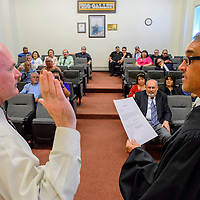 031615  Adron Gardner/Independent<br /> <br /> Alan Landavazo, left, is sword in as a city councilor by district court judge Louis E. DePauli at City Hall in Gallup Monday.