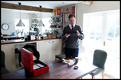 The Prime Minister David Cameron catches up on his work and checks his Ipad as he stops for lunch at his house in Dean, Thursday March 11, 2011. Photo By Andrew Parsons / i-Images.