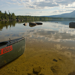 A canoe on the shoreline of Katahdin Lake in Maine's Baxter State Park.