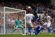 Wilfried Zaha of Crystal Palace takes a shot past Branislav Ivanovic, the Chelsea standing captain. Barclays Premier League, Chelsea v Crystal Palace at Stamford Bridge in London on Saturday 29th August 2015.<br /> pic by John Patrick Fletcher, Andrew Orchard sports photography.