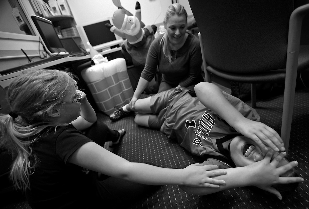 Parker Roos, who suffers from Fragile X, is tickled by his mother Holly and his sister Allison during a check up at the Fragile X Clinic and Research Program at Rush University Medical Center in Chicago, April 11, 2012.  REUTERS/Jim Young