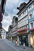Intricate frescoes decorate buildings on Hauptgasse (Main Street) in Appenzell village, in Switzerland, Europe. Appenzell Innerrhoden is Switzerland's most traditional and smallest-population canton (second smallest by area).