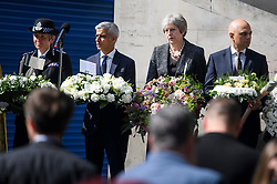 © Licensed to London News Pictures. 03/06/2018. London, UK. Met police commissioner CRESSIDA DICK, London Mayor, SADIQ KHAN, British Prime Minister THERESA AMY and Home Secretary SAJID JAVID mark a minutes silence for the victims of the 2017 London Bridge Terror attack, held on London Bridge. Eight people were killed and 48 were injured when a van was deliberately driven into pedestrians on London Bridge. Three occupants then ran to the nearby Borough Market area carrying knives and fake explosives. Photo credit: Ben Cawthra/LNP