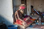 Old skinny sadhu living in the streets of Pushkar (India)