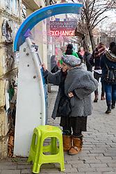 Older Woman At ATM Machine