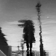 France Paris- people shadow in the street, le marais,