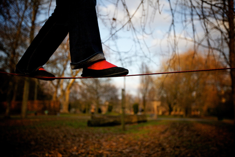 Photographer and Slackliner Claudia Simo?es performing for a photo shoot in Bute Park, Cardiff.