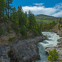 Montana's Boulder River briefly disappears into a limestone tunnel above Natural Bridge Falls - a spectacular waterfall at higher water levels.