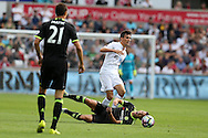 Jack Cork of Swansea city fouls Eden Hazard of Chelsea.Premier league match, Swansea city v Chelsea at the Liberty Stadium in Swansea, South Wales on Sunday 11th Sept 2016.<br /> pic by  Andrew Orchard, Andrew Orchard sports photography.