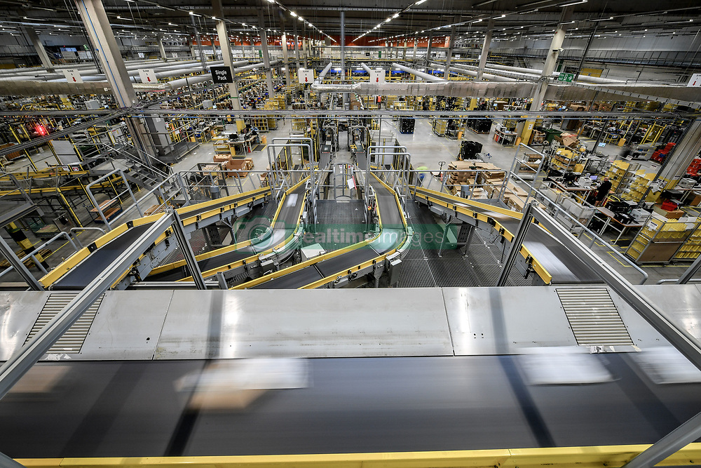 Parcels fly past on conveyor belts at Amazon's fulfillment centre in Swansea, in the run up to Black Friday.