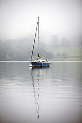 September 14, 2016 - Glenridding, Cumbria, UK - Glenridding UK. Picture shows a boat on the still water of Ullswater Lake in the morning mist at Glenridding this morning. After last nights thunderstorms in the north of England Cumbria woke to a calm but misty morning. (Credit Image: © Andrew Mccaren/London News Pictures via ZUMA Wire)