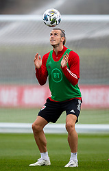 CARDIFF, WALES - Wednesday, September 2, 2020: Wales' captain Gareth Bale heads the ball during a training session at the Vale Resort ahead of the UEFA Nations League Group Stage League B Group 4 match between Finland and Wales. (Pic by David Rawcliffe/Propaganda)