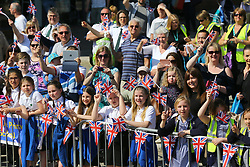 Members of the public wait for the victory bus tour through Sevenoaks, Kent. PRESS ASSOCIATION Photo. Picture date: Wednesday April 18, 2018. Yarnold became the first Briton - and the first skeleton athlete - to win successive Winter Games gold medals. Photo credit should read: Gareth Fuller/PA Wire