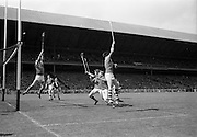 03/09/1967<br /> 09/03/1967<br /> 3 September 1967<br /> All-Ireland Minor Hurling Final: Cork v Wexford at Croke Park, Dublin.<br /> Cork captain, Paddy Ring (right), scoes a point which the Wexford goalie failed to save or deflect.