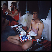 Young men take a rest as they exercise boxing in a gym in the outskirts of Kabul.