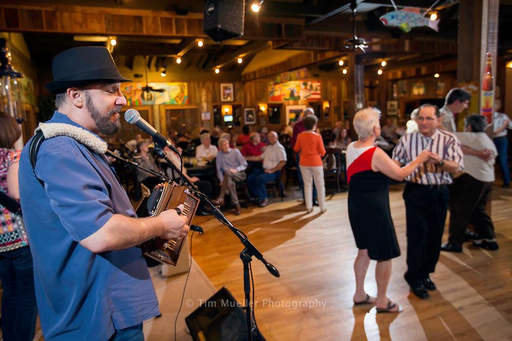 Lee Benoit and his Cajun band perform Saturday night's at Boutin's in Baton Rouge, La.