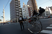Tourists ride a rickshaw in front of Tokyo Skytree, Asakusa, Tokyo Japan Sunday February 10th 2013