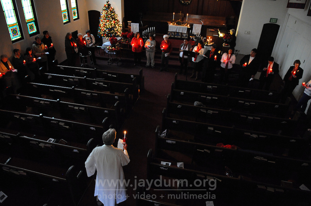 Pastor Jim Luther leads a Christmas Eve candlelight service at the United Methodist Church in Salinas.