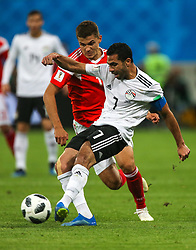 June 19, 2018 - Saint Petersburg, Russia - Ahmed Fathi of the Egypt national football team vie for the ball during the 2018 FIFA World Cup match, first stage - Group A between Russia and Egypt at Saint Petersburg Stadium on June 19, 2018 in St. Petersburg, Russia. (Credit Image: © Igor Russak/NurPhoto via ZUMA Press)